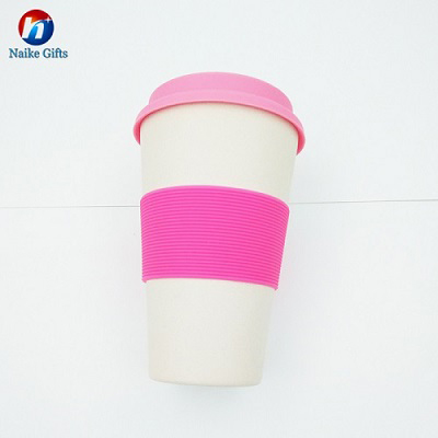 Superior quality eco friendly bamboo coffee cup with silicone lid and sleeve title=